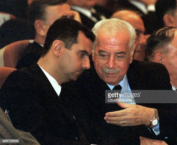 Syrian heir apparent Bashar alAssad son of the late president Hafez alAssad and Defence Minister Mustafa Tlass attend the opening session of the...