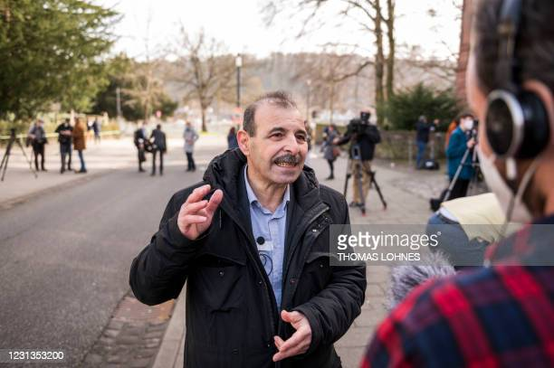 Syrian human rights lawyer Anwar al-Bunni talks to the medias in front of the court after the verdict in the trial of a Syrian defendant accused of...