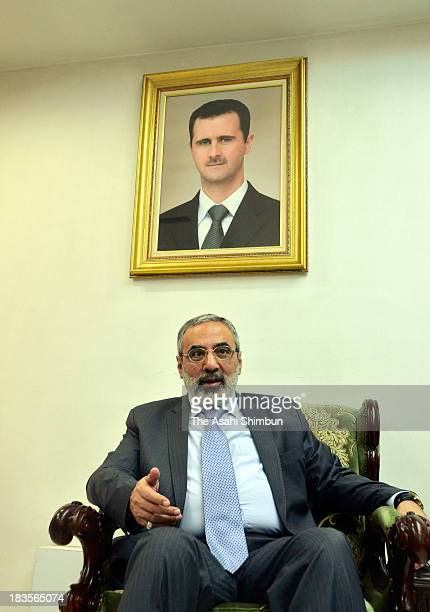 Syrian Information Minister Omran alZoubi speaks during the Asahi Shimbun interview on October 5 2013 in Damascus Syria The minister insisted that...