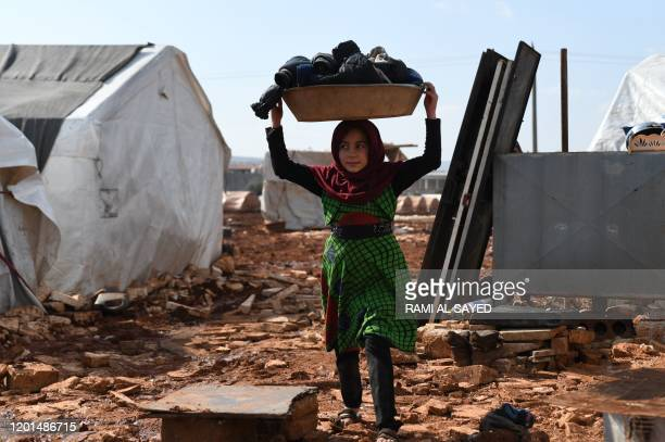 Syrian internally-displaced persons are pictured in a camp in Sarmada in the north of Syria's northwestern Idlib province on February 17, 2020.