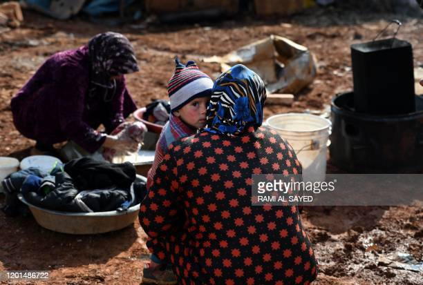 TOPSHOT Syrian internallydisplaced persons are pictured in a camp in Sarmada in the north of Syria's northwestern Idlib province on February 17 2020