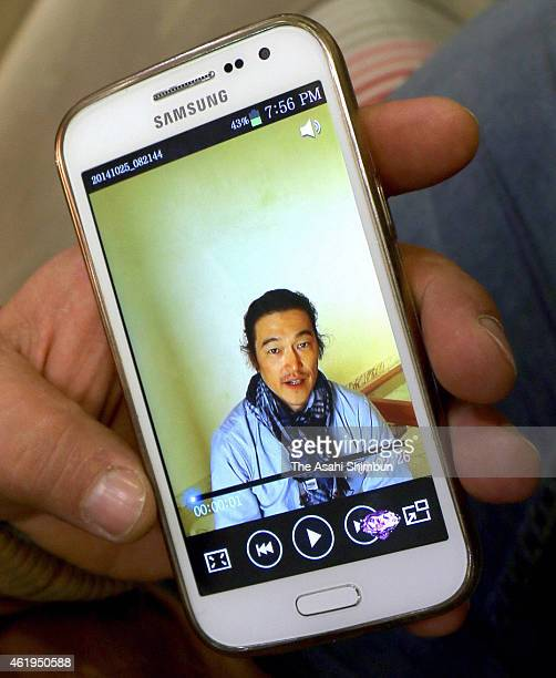 Syrian interpreter and journalist Alaaeddin Al-Zaeem shows the video message he took with his mobile phone on October 24, 2014 before one of Japanese...