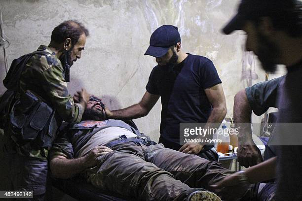 Syrian is carried to a field hospital to receive treatment following a chlorine gas attack by Assad regime forces in Jobar town of Damascus Syria on...