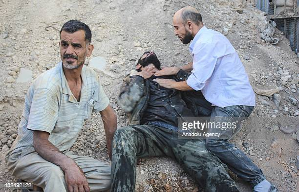 Syrian is wounded during a chlorine gas attack by Assad regime forces in Jobar town of Damascus Syria on July 31 2015