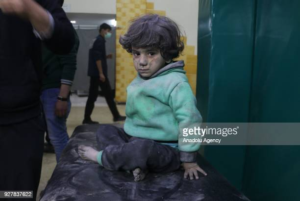Syrian kid is seen after receiving medical treatment at the field hospital after Assad Regime's alleged chlorine gas attack in Hamouriyah district of...