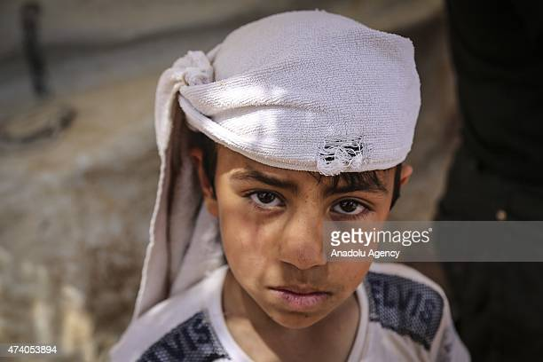 Syrian kid is seen at Atmeh refugee camp in Idlib Syria on May 19 2015 More than 60 thousand refugees fled their homes due to the attacks of Assad's...