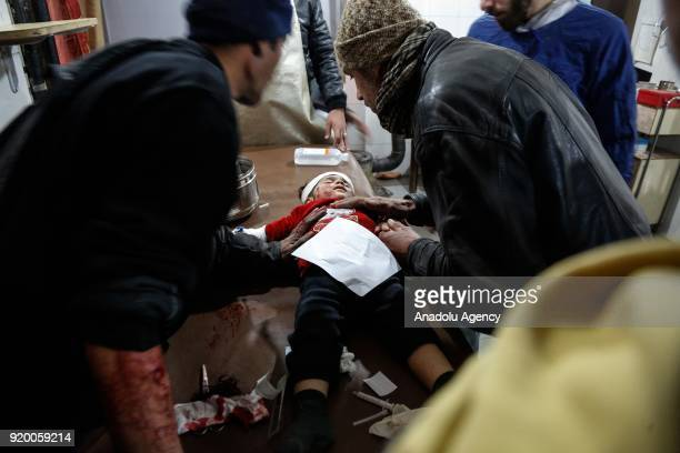 Syrian kid receives medical treatment after war planes belonging to Assad Regime carried out airstrikes at the residential areas of Kafr Batna town...