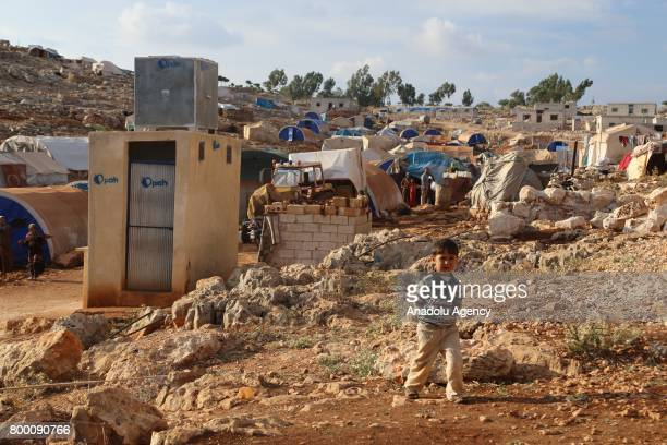 Syrian kid walks around outside of his camp during Muslim's holy month of Ramadan in Idlib Syria on June 23 2017 Ahead of Eid al Fitr Syrian people...