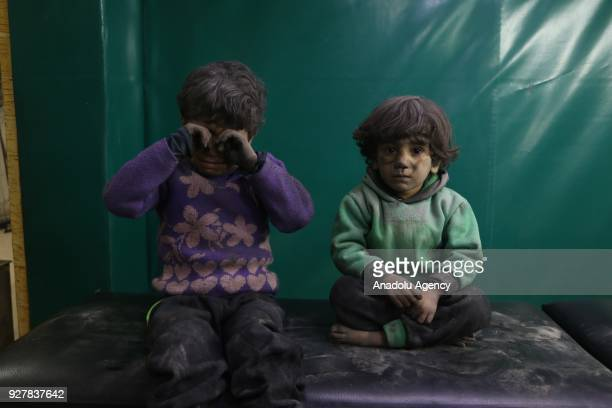 Syrian kids are seen after receiving medical treatment at the field hospital after Assad Regime's alleged chlorine gas attack in Hamouriyah district...