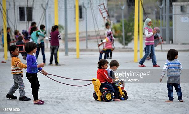 Syrian kids fled from the civil war play as they live in refugee camp in Nizlip district of Gaziantep Turkey on April 15 2015