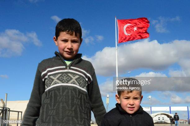 Syrian kids pose for a photo at a tent camp, built by Prime Minister's Disaster and Emergency Management in Suruc district of Sanliurfa, Turkey on...
