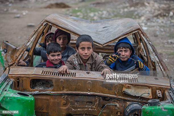 Syrian kids pose for a photograph inside a wreckage of a car as Syrians live freely against all odds in Jarabulus after its cleansing of Daesh...