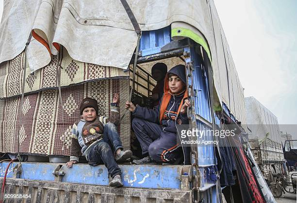 Syrian kids who fled bombing in Aleppo sit on truck haulage at a tent city close to the Bab alSalam border crossing on TurkishSyrian border near Azaz...