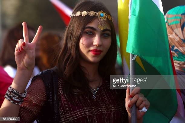 A Syrian Kurd gestures in the northeastern Syrian city of Qamishli on September 26 during a gathering in support of the independence referendum in...