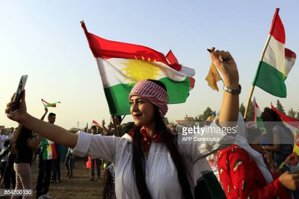 A Syrian Kurd takes a selfie in the northeastern Syrian city of Qamishli on September 26 during a gathering in support of the independence referendum...
