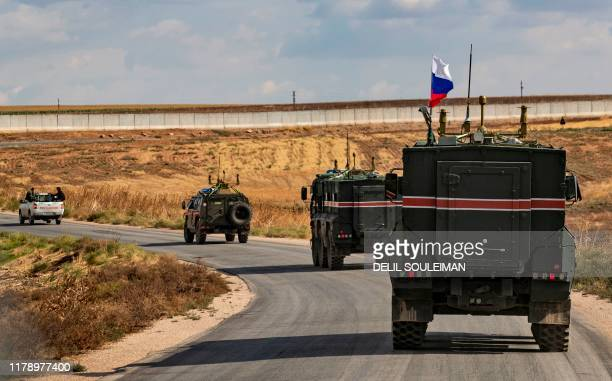 TOPSHOT Syrian Kurdish Asayish internal security forces and Russian military police patrol the town of Darbasiyah in Syria's northeastern Hasakeh...