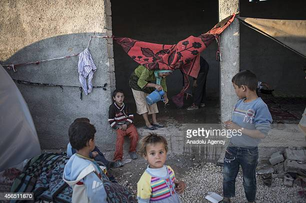 Syrian Kurdish children fled from the clashes between Islamic State of Iraq and the Levant and Syrian Kurdish armed groups in Ayn alArab city try to...