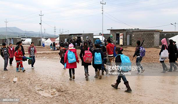 Syrian Kurdish children fled from the clashes between Islamic State of Iraq and Levant and armed groups in Ayn alArab walk to the school at Arbat...