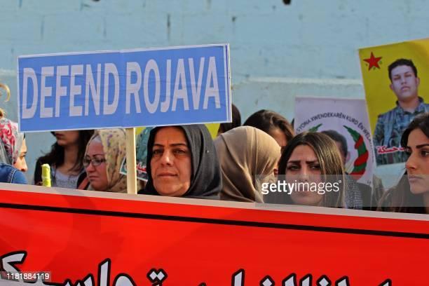Syrian Kurdish demonstrators take to the streets of the northeastern city of Qamishli the defacto capital of Syria's embattled Kurdish minority on...