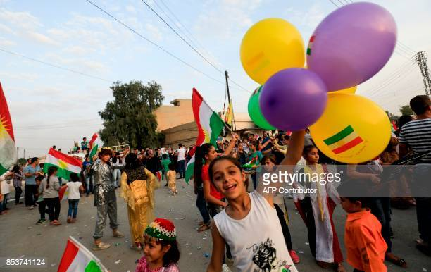 A Syrian Kurdish girl celebrates with balloons in the northeastern Syrian city of Qamishli on September 25 in support of the independence referendum...