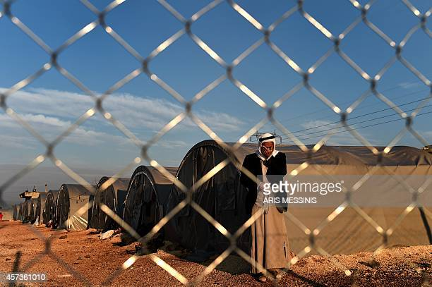 Syrian Kurdish man stands in a refugee camp in the town of Suruc, Sanliurfa province, on October 17, 2014. Kurdish rebels have been infuriated by the...