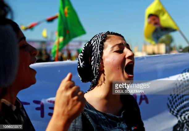 A Syrian Kurdish protester chants slogans during a demonstration in the town of alQahtaniyah in the Hasakeh province near the SyrianTurkish border on...