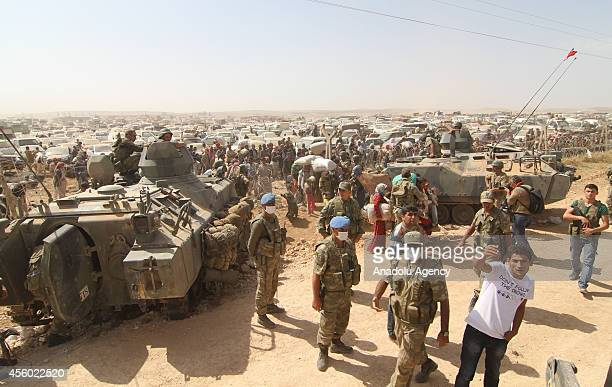 Syrian Kurdish refugees are seen as they enter into Suruc town of Sanlurfa southeastern province of Turkey after fleeing from clashes between the...