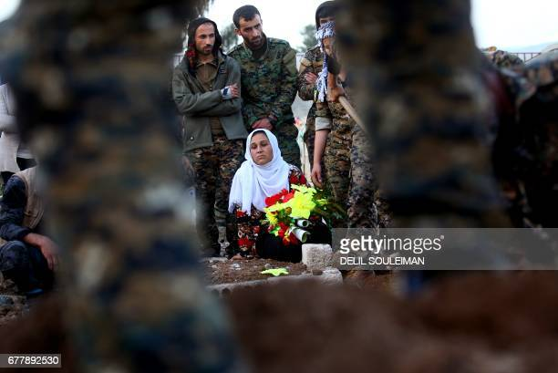 Syrian Kurdish woman mourns during the funeral of fighters from the Kurdish People's Protection Units who were killed during battles in the...