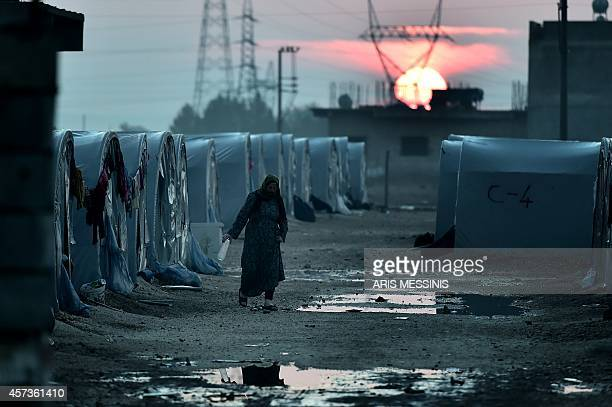 A Syrian Kurdish woman walks in a refugee camp in the town of Suruc Sanliurfa province on October 17 2014 Kurdish rebels have been infuriated by the...