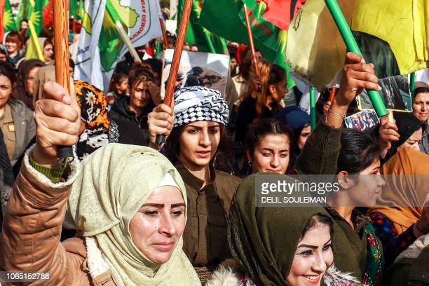 TOPSHOT Syrian Kurdish women demonstrate in the northeastern Syrian city of Qamishli on November 25 as they mark the International Day for the...