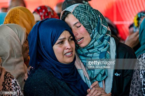 Syrian Kurdish women mourn during a funeral in Qamishli in the northeastern Hasakeh province on November 7 for fighters from the Kurdishmajority...