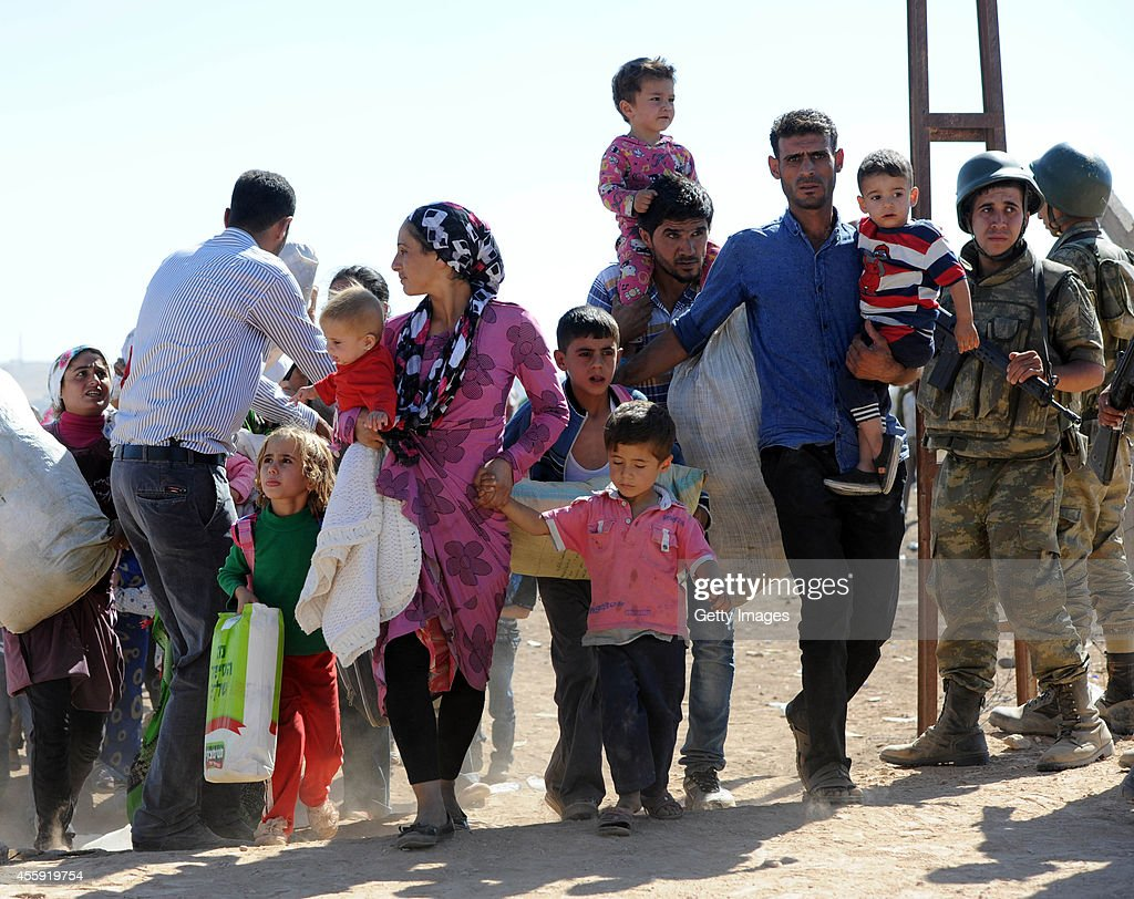 Syrian Kurds Fleeing The Islamic State Militants Cross Into Turkey : News Photo