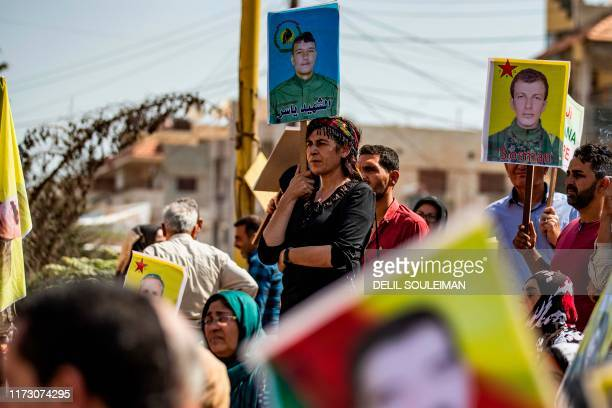 Syrian Kurds demonstrate in front of the United Nations offices in the Kurdish-majority city of Qamishli in northeast Syria on October 2, 2019 over...