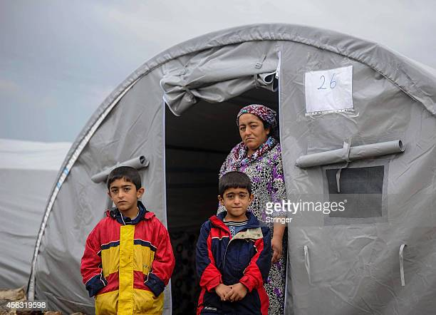 Syrian Kurds in a refugee camp serving as a temporary shelter for refugees near the Syrian border town of Suruc in Sanliurfa province, September 29,...