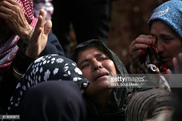 TOPSHOT Syrian Kurds mourn in the northern town of Afrin during the funeral on February 1 2018 of fighters from the People's Protection Units militia...