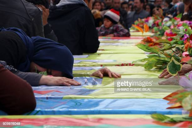 Syrian Kurds mourn in the northern town of Afrin during the funeral on March 1 2018 of fighters from the People's Protection Units militia and the...