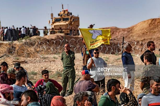 Syrian Kurds take part in a demonstration against Turkish threats in the town of Ras al-Ain in Syria's Hasakeh province near the Turkish border on...