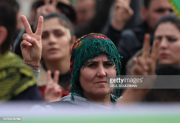 Syrian Kurds take part in a demonstration in the northeastern Syrian Kurdishmajority city of Qamishli on December 28 against threats from Turkey to...