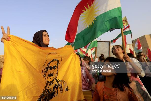 Syrian Kurds wave the Kurdish flag in the northeastern Syrian city of Qamishli on September 26 during a gathering in support of the independence...