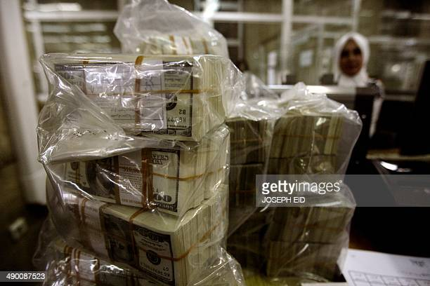 Syrian lira bills are stacked in bags at the Central Bank in Damascus on August 25 2011 US sanctions have forced Syria to stop all transactions in US...
