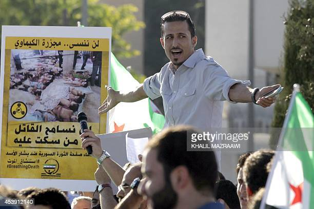 A Syrian living in Jordan shouts slogans against Syrian President Bashar alAssad during a rally outside of the Syrian Embassy in the capital Amman on...