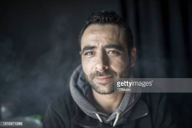 syrian male portrait - refugee camp stock pictures, royalty-free photos & images