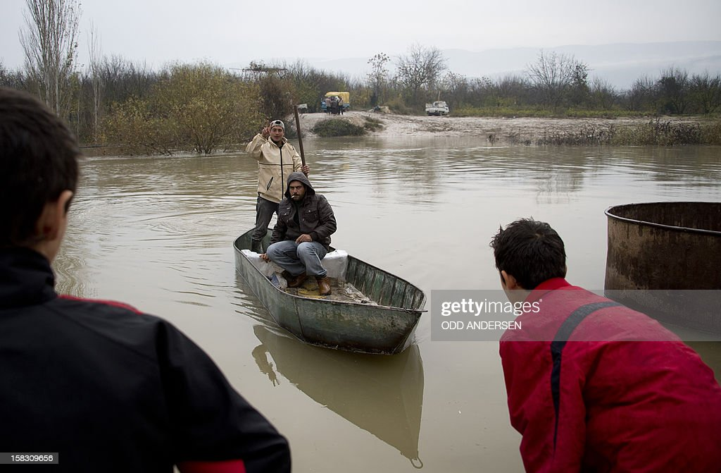 A Syrian man arrives aboard a boat to the Turkish side of the Orontes river after fleeing from the northern Syrian town of Darkush on December 13, 2012. The number of Syrian refugees registered in neighbouring countries and North Africa has passed half a million, the UN's refugee body said, adding that many more have not come forward to seek help.