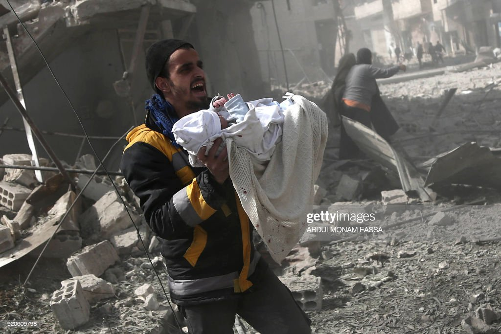 At least 100 civilians killed in a Syrian bombardment of the rebel-held enclave of Eastern Ghouta