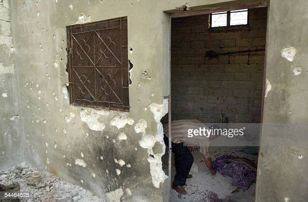 Syrian man checks 03 September 2005 the hideout where five members of the Islamist militant group Jund alSham were killed in clashes with Syrian...