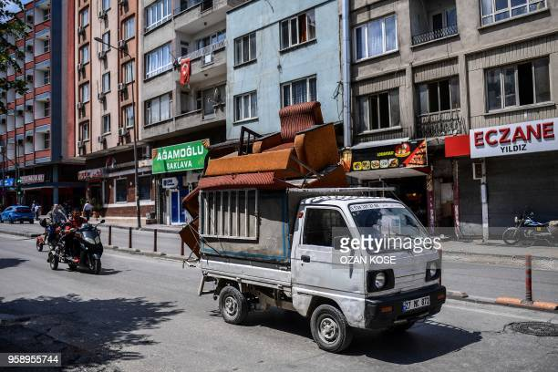 A Syrian man drives a vehicle transporting furniturtes on May 1 2018 in Gaziantep southwestern Turkey In the Turkish city of Gaziantep home to around...