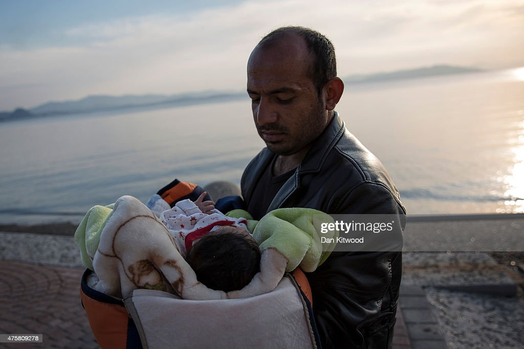 A Syrian man holds his child aftre after being escorted into the harbour by the Greek Coastguard who found them drifing offshore on June 04, 2015 in Kos, Greece. Many migrants are continuing to arrive on the Greek Island of Kos from Turkey. The Island has recently seen a drop in tourist numbers which has been attributed to negative reports on the migrant crisis that is continuing to grip the area. Many migrants are continuing to arrive on the Greek Island of Kos from Turkey. Around 30,000 migrants have entered Greece so far in 2015, with the country calling for more help from its European Union counterparts.