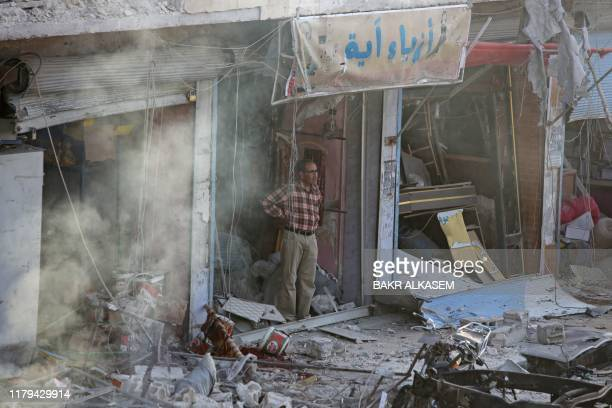 Syrian man inspects the site of a car bomb explosion in the northern Syrian Kurdish town of Tal Abyad, on the border with Turkey, on November 2, 2019.