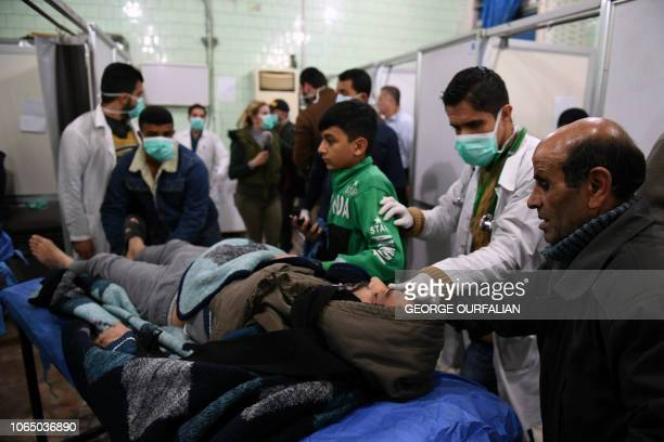 A Syrian man is brought in for treatment at a hospital in the regime controlled Aleppo on November 24 2018 Official Syrian media accused the armed...