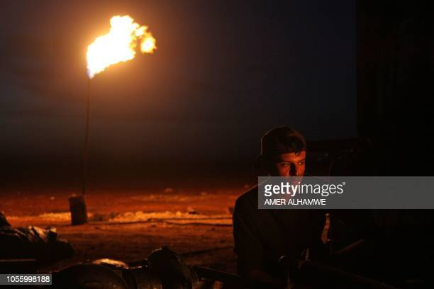 A Syrian man is pictured on October 31 2018 at a primitive oil facility in the town of Zardana in the countryside of the northwestern Syrian Idlib...